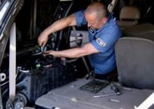 Technician Repairing Rear A/C Unit