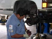 Technician Checking Wheel Bearings