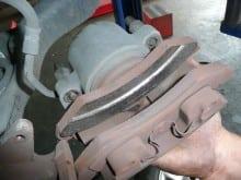 Irregularly worn brake pads.