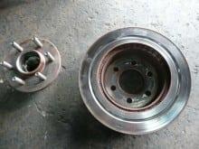 Grooved brake rotor found on vehicle.