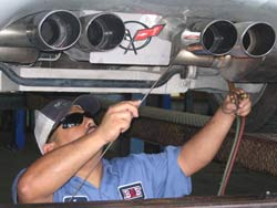 Welding in some stainless steel tips on a Corvette.