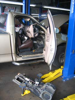 This picture shows the evaporator plenum assembly just being removed from a Ford Truck.
