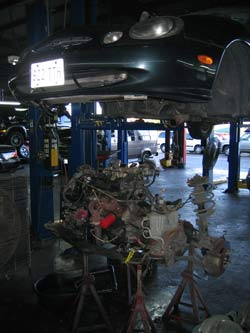 A cooling system pressure test revealed leaking freeze plugs on the back of the engine block on this Ford Taurus.